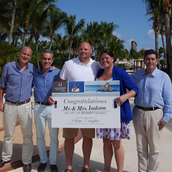 Pictured from left to right: Christopher Payne, Secrets Maroma Beach Riviera Cancun General Manager; Uriel Valero, UVC Marketing & Sales Director; Steve and Angela Isakson, the 50,000th UVC members; and Jorge Herrera, UVC Managing Director.